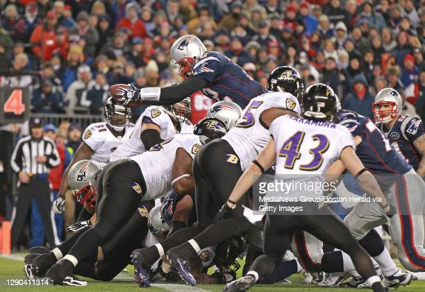 Foxboro, MA ÑNew England Patriots quarterback Tom Brady rushes over the top for a fourth quarter touchdown during a 23-20 victory in the AFC...