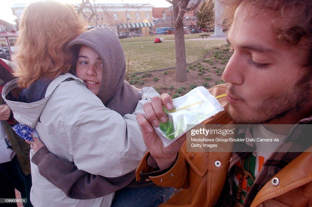 Foxfire, right, sips on juice as, Ilene, right, executive