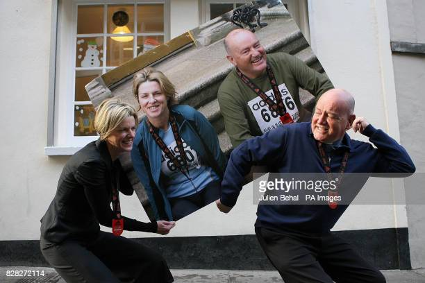 Foxrock curate Fr Paul Ward and one of his parishoners Yvonne Clancy hold a picture of themselves outside the Focus offices Dublin Friday December 23...