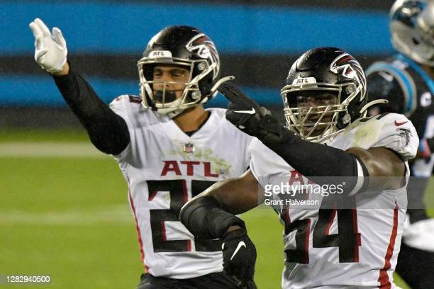 Foye Oluokun and Isaiah Oliver of the Atlanta Falcons celebrate a fourth down stop against the Carolina Panthers during the third quarter at Bank of...