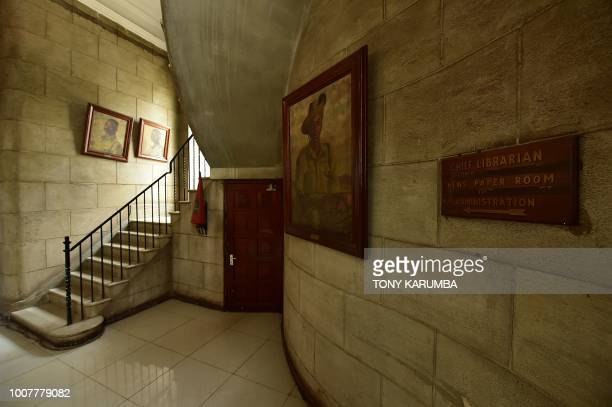 A foyer bearing antique paintings and book copies from Kenya's preindependence period is pictured inside the colonialera McMillan Memorial Library in...