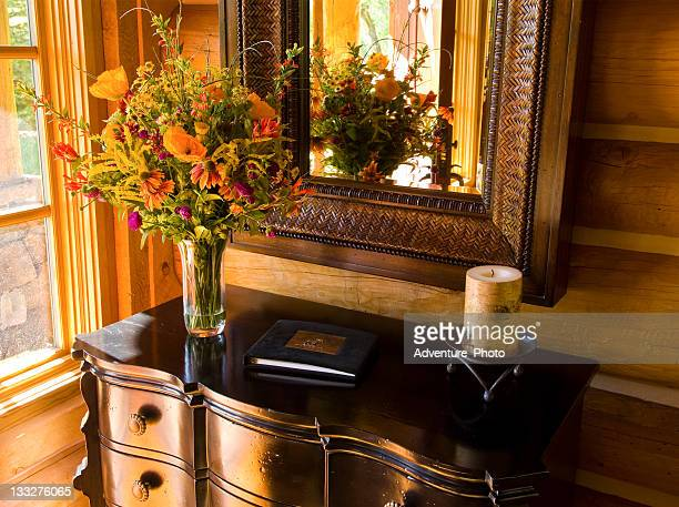 Foyer Table at Home Entrance with Flowers and Guest Book
