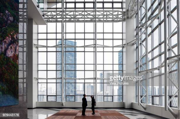 Foyer with full-height fenestration. G-Tower in Incheon, Incheon, Korea, South. Architect: HAEAHN Architecture, 2013.