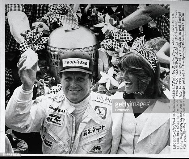 Foyt, Jr., Houston, Texas, holds a piece of ice to cool off after he won his record fourth '500' 5/29. At right is 500 Festival Queen Kelly Hegg....