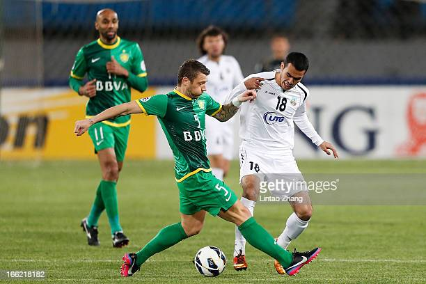 Fozil Musaev of Bunyodkor challenges Matic Darko of Beijing Guoan during the AFC Champions League Group match between Bunyodkor and Beijing Guoan at...
