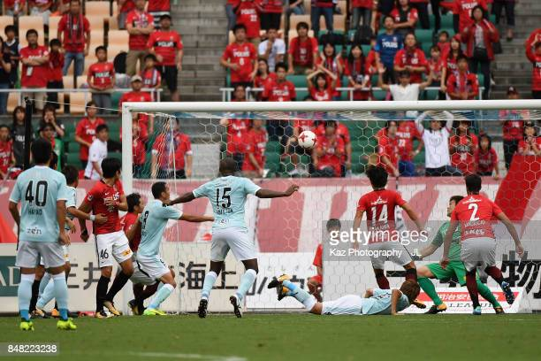 Fozil Musaev of Jubilo Iwata heads the ball to score the opening goal during the JLeague J1 match between Jubilo Iwata and Urawa Red Diamonds at...