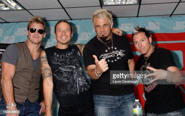 Fozzy Chris Jericho Rich Ward Frank Fontsere and Billy Grey attend Fozzy CD signing at JR Music World on August 29 2012 in New York City