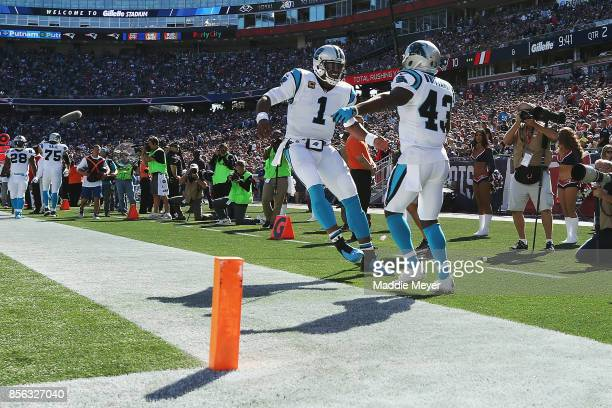 Fozzy Whittaker of the Carolina Panthers celebrates with Cam Newton after scoring a touchdown during the second quarter against the New England...