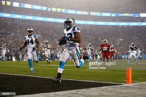Fozzy Whittaker of the Carolina Panthers runs for a touchdown against the Arizona Cardinals after a 3rd quarter reception during their NFC Wild Card...