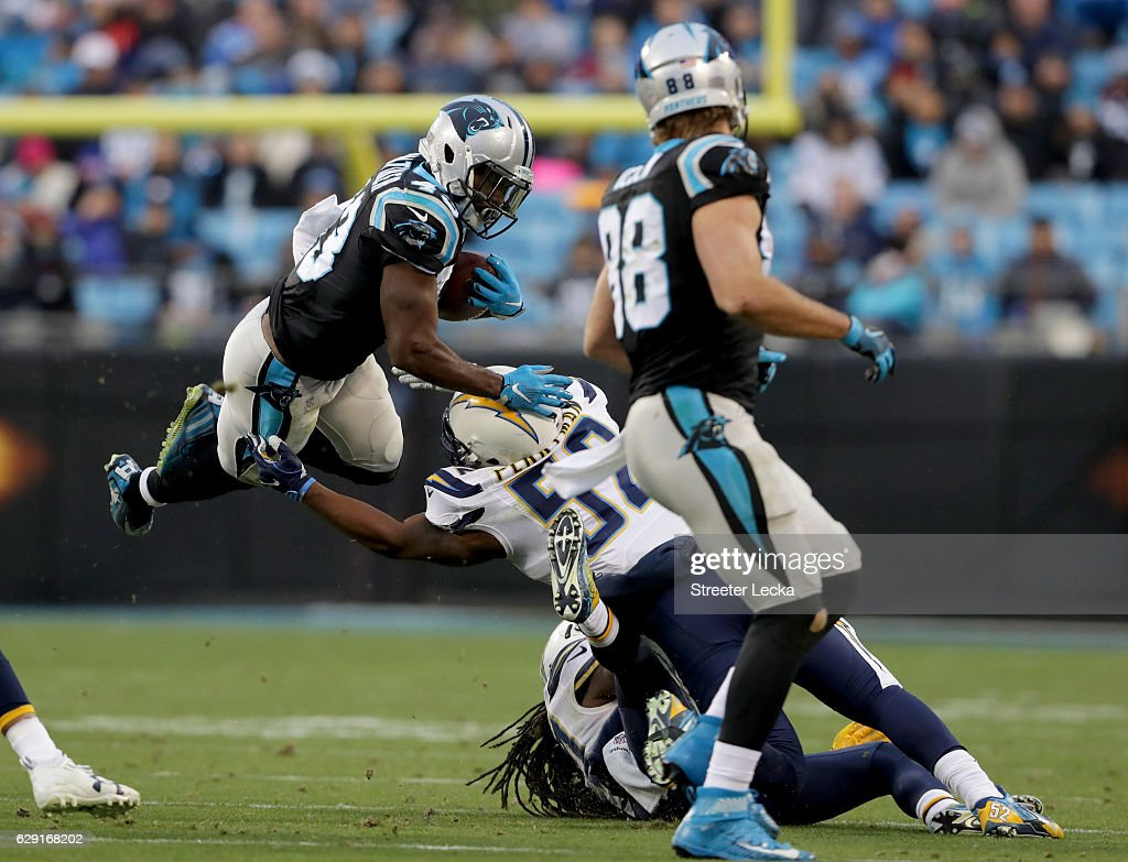 Fozzy Whittaker #43 of the Carolina Panthers runs the ball against Denzel Perryman #52 of the San Diego Chargers in the 4th quarter during their game at Bank of America Stadium on December 11, 2016 in Charlotte, North Carolina.