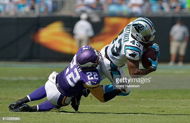 Fozzy Whittaker of the Carolina Panthers runs the ball against Harrison Smith of the Minnesota Vikings in the 1st quarter during the game at Bank of...