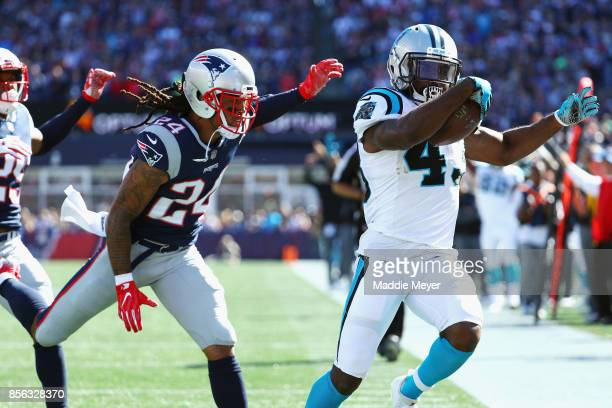 Fozzy Whittaker of the Carolina Panthers scores a touchdown during the second quarter against the New England Patriots at Gillette Stadium on October...