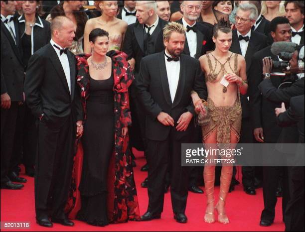Fr L to R Actors Bruce Willis and wife Demi Moore next to French director Luc Besson and actress Milla Jovovich pose for photographers prior the...