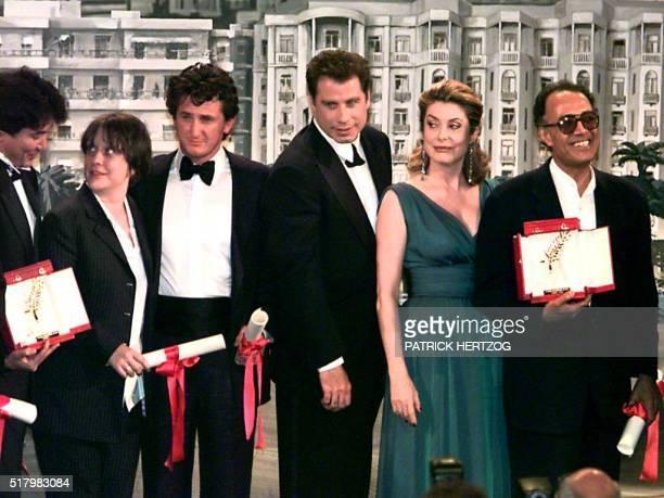 Fr L to R Chinese director Wong KarWai British actress Kathy Burke US actor Sean Penn US actor John Travolta French actress Catherine Deneuve and...