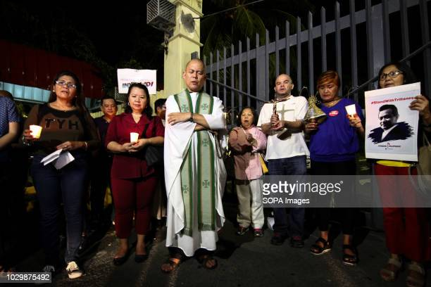Fr Robert Reyes seen leading the prayer mass Supporters of Senator Antonio Trillanes IV led by Fr Robert Reyes held a prayer mass outside the Senate...