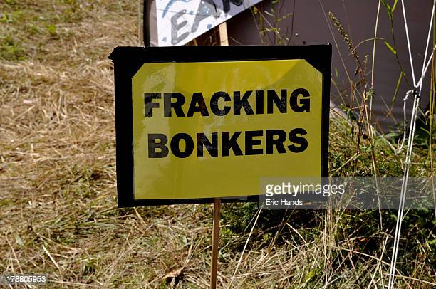 CONTENT] Fracking Bonkers reads a protest sign at the roadside near to a drilling test site in Balcombe Sussex England UK