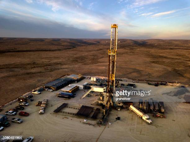 fracking drilling rig at dusk or dawn - anti fracking demonstration stock photos and pictures