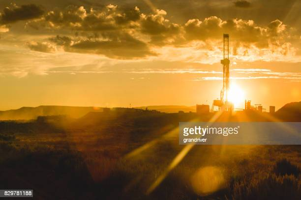 fracking drilling rig at the golden hour - wild west stock pictures, royalty-free photos & images