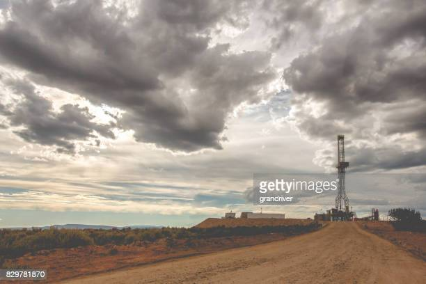 Fracking Drilling Rig Under a Dramatic Cloudy Sky