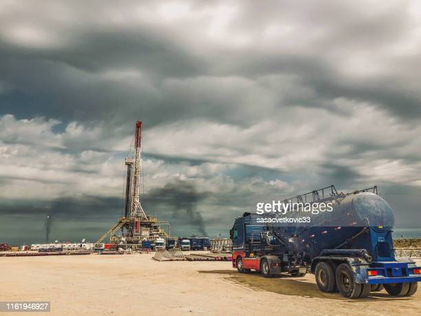 fracking oil rig at sunset - fracking stock pictures, royalty-free photos & images