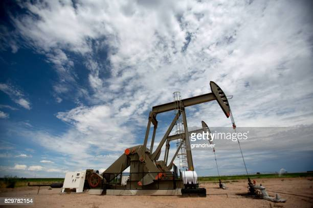 fracking pumpjacks in the oil field - fracking stock pictures, royalty-free photos & images
