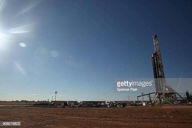 A fracking site is situated on the outskirts of town in the Permian Basin oil field on January 21 2016 in the oil town of Midland Texas Despite...