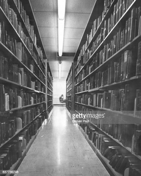 A fraction of nine miles of bookshelves are shown in CSU's new William E Morgan Library which holds 600000 volumes and has 2000 reader seating...
