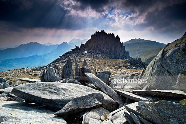Fractured rock formations at Castell y Gwynt near the Summit of Glyder Fach backed by Mount Snowdon Glyder Fach Wales