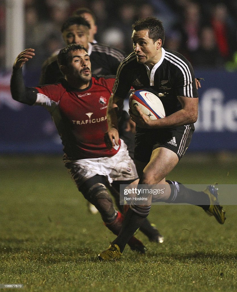 Frae Wilson of the Maori All Blacks attempts to break away from Phil Mack of Canada during a tour match between Canada and Maori All Blacks at Oxford University Rugby Club on November 23, 2012 in Oxford, England.
