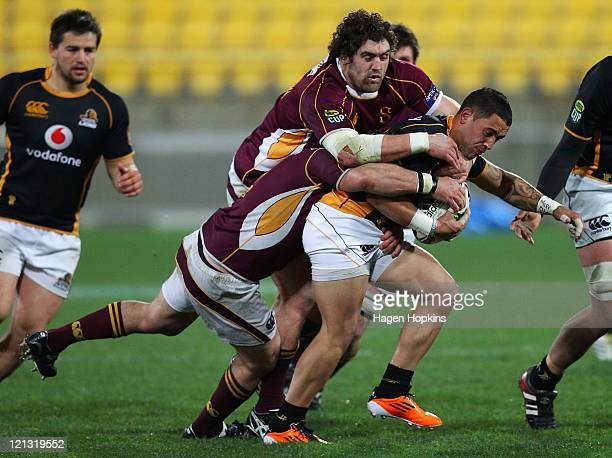 Frae Wilson of Wellington is tackled by Jamie MacKintosh of Southland during the round eleven ITM Cup match between Wellington and Southland at...