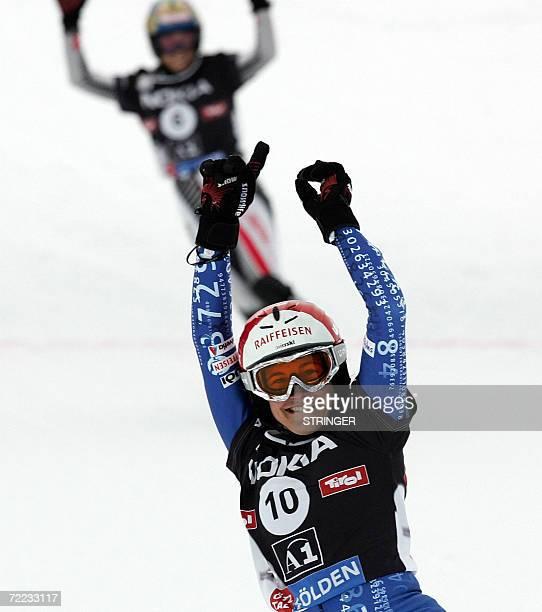 Fraenzi Kohli of Switzerland celebrates her win ahead of Doresia Krings of Austria at the Parallel Snowboard Slalom World Cup in Soelden Austria 21...