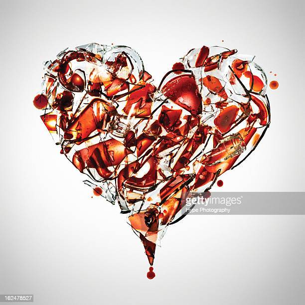 fragile heart concept - bloody heart stock photos and pictures