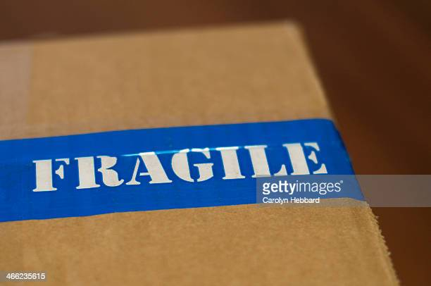 fragile sticker on packing box - fragile sticker stock pictures, royalty-free photos & images