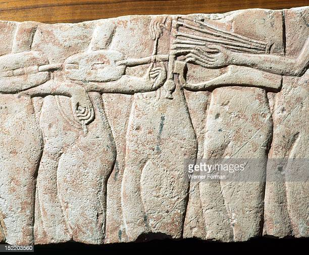 A fragment of a relief Court musicians During the Amarna period the need for speedy erection of new temples for Aten led to the use of smaller now...