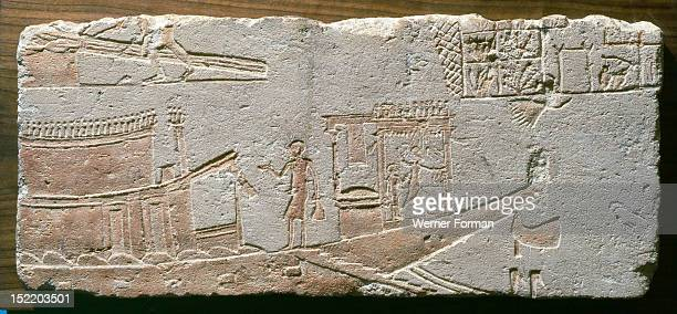 A fragment of a reliefAkhenatens state barge At the stern is a kiosk decorated with a relief of the king slaughtering his enemies Behind Akhenaten...