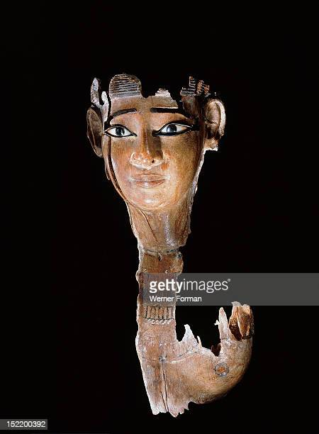 Fragment of a wooden statue destroyed by termites leaving a finely carved face with heavy eye make up Egypt Ancient Egyptian Middle Kingdom Twelfth...