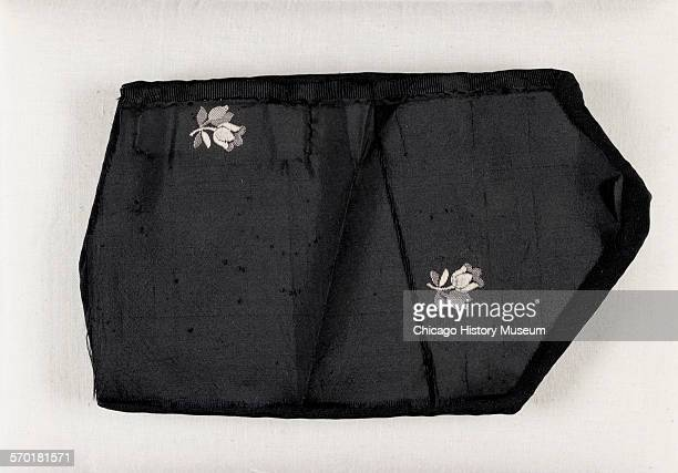 Fragment of black taffeta from gown worn by Mary Todd Lincoln at Ford's Theater on the evening of Abraham Lincoln's assassination Washington DC April...