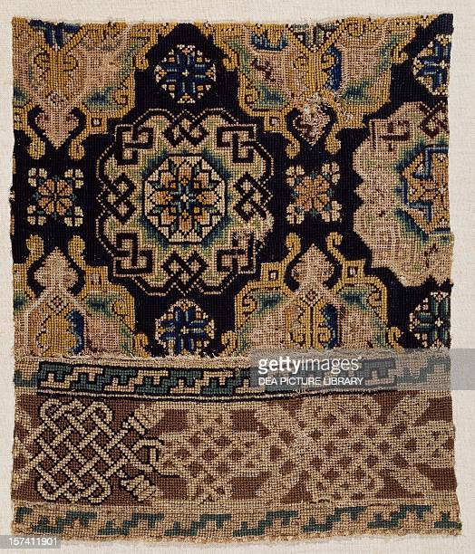Fragment of carpet with cross stitch wool on linen canvas ca 1600 Drawing taken from a Holbein style carpet France 17th century London Victoria And...