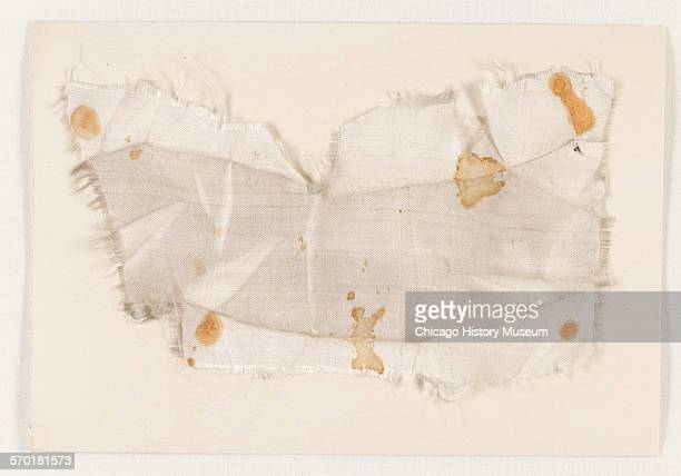 Fragment of silk from gown worn by Miss Clara Harris who with Major Rathbone Abraham Lincoln's bodyguard accompanied Abraham and Mary Todd Lincoln to...