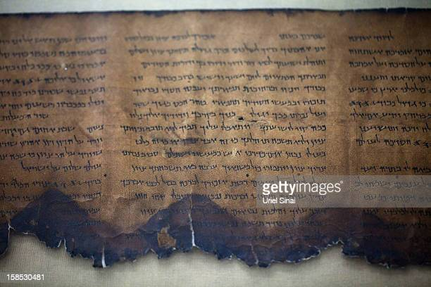 A fragment of the 2000yearold Dead Sea scrolls is laid out at a laboratory on December 18 2012 in Jerusalem Israel More than sixty years after their...
