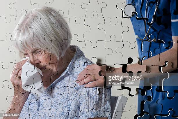 Fragmenting jigsaw image of carer and senior woman