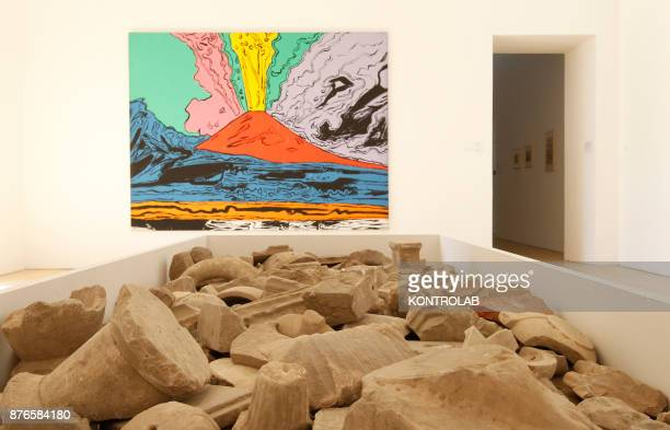 MUSEUM NAPLES CAMPANIA ITALY Fragments of marble decorations are displayed next to the work 'Vesuvius' by Andy Warhol in the exibition Pompei@madre...
