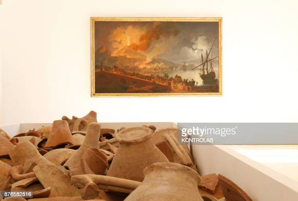 MUSEUM NAPLES CAMPANIA ITALY Fragments of pottery are displayed next to the work dated 1782 'Vesuvius eruption from the Maddalena Bridge' by Pierre...