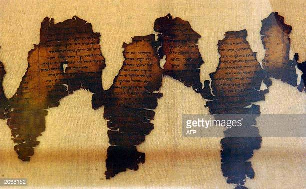 Fragments of the Dead Sea Scrolls considered one of the greatest archeological discoveries of the 20th century are displayed 18 June 2003 at...