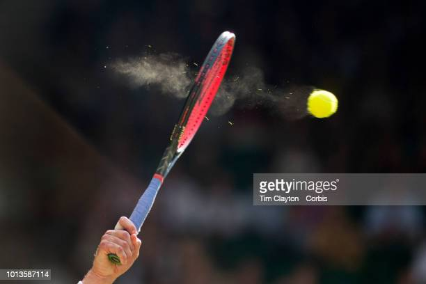 Fragments of the tennis ball captured during the force of the serve of John Isner of the United States in action against Kevin Anderson of South...
