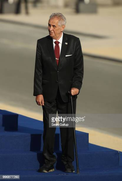 A frail looking Czech President Milos Zeman arrives for a group photo at the evening reception and dinner at the 2018 NATO Summit on July 11 2018 in...