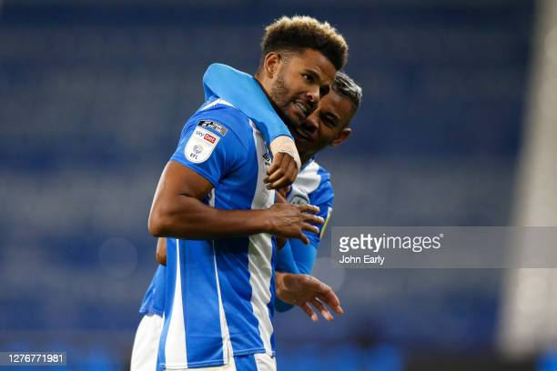 Fraizer Campbell and Juninho Bacuna of Huddersfield Town celebrate during the Sky Bet Championship match between Huddersfield Town and Nottingham...