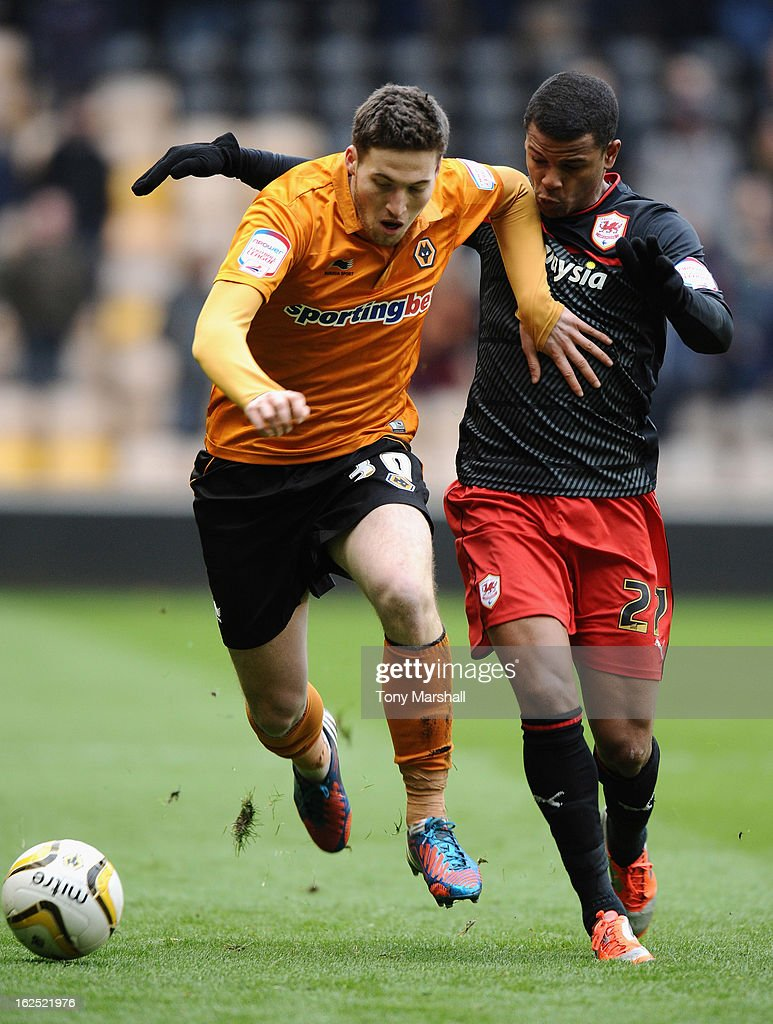 Fraizer Campbell of Cardiff battles with Matt Doherty of Wolves during the npower Championship match between Wolverhampton Wanderers and Cardiff City at Molineux on February 24, 2013 in Wolverhampton, England.