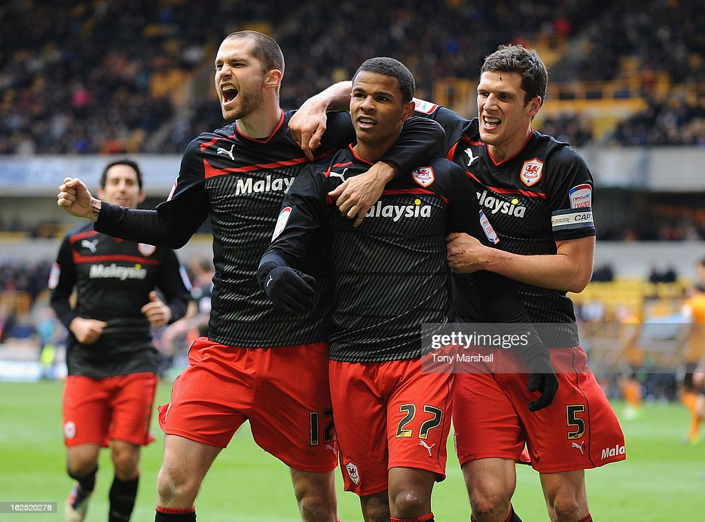 Fraizer Campbell of Cardiff (centre) celebrates scoring their second goal during the npower Championship match at Molineux on February 24, 2013 in Wolverhampton, England.