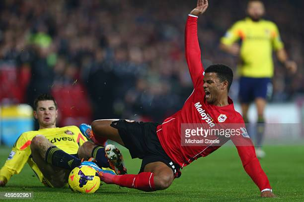 Fraizer Campbell of Cardiff City is fouled by Valentrin Roberge of Sunderland during the Barclays Premier League match between Cardiff City and...